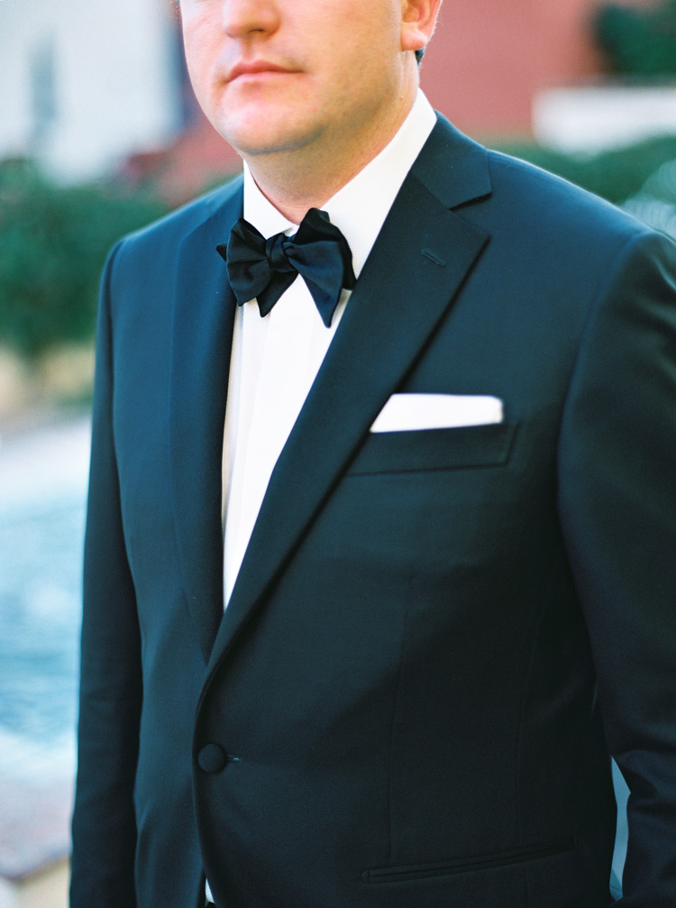 Black and white suit and bow tie of groom.