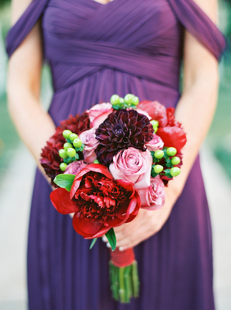 Jewel and deep toned bouquet for bridesmaid.