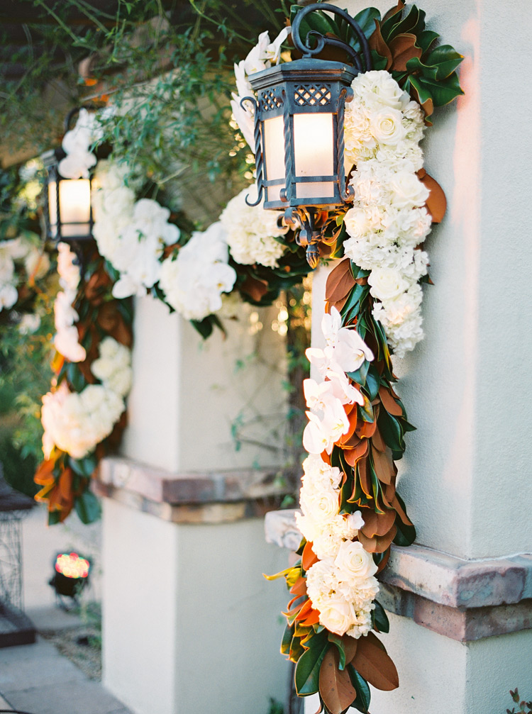 Hanging white orchid and roses decor. Scottsdale weddings at Omni Montelucia.