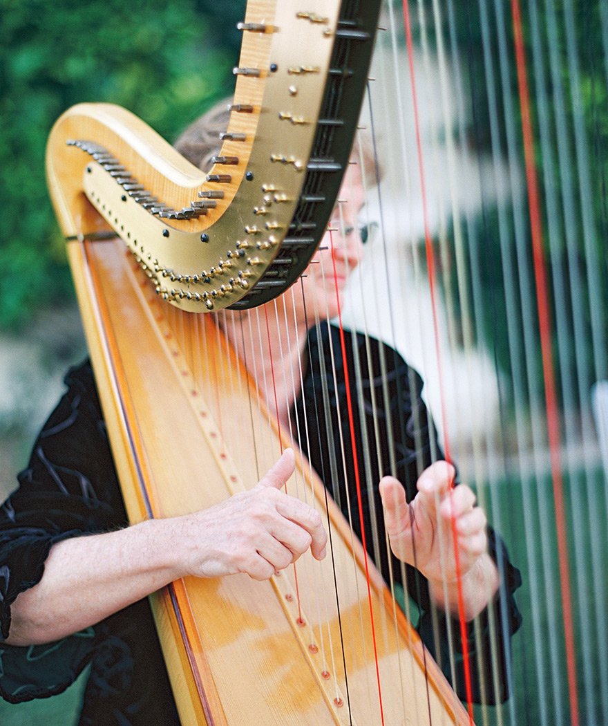 Orchestra strums harp during wedding ceremony. Scottsdale weddings.