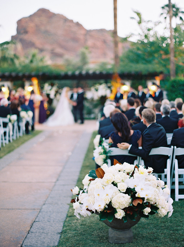 White modern pot of flower arrangement focus during ceremony .