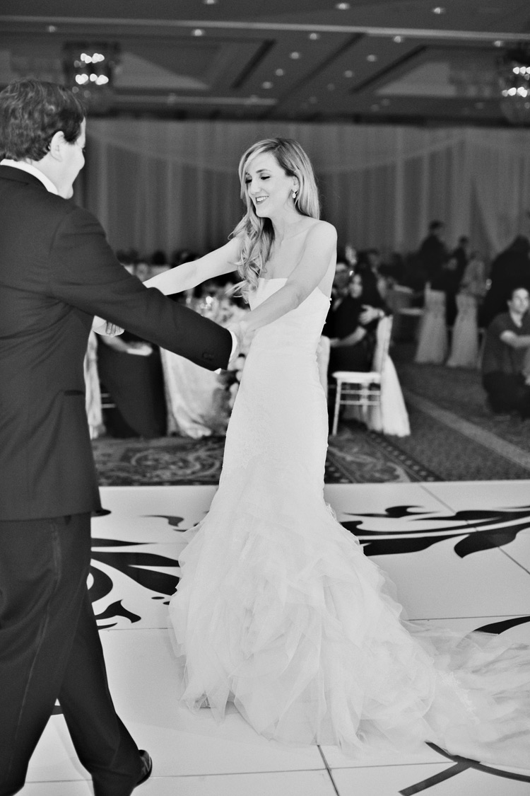 Bride and groom sway arms during first dance. Omni Montelucia weddings.