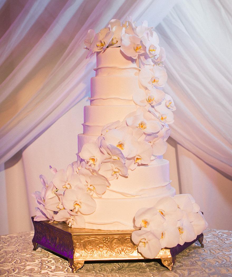 White orchid layered wedding cake.