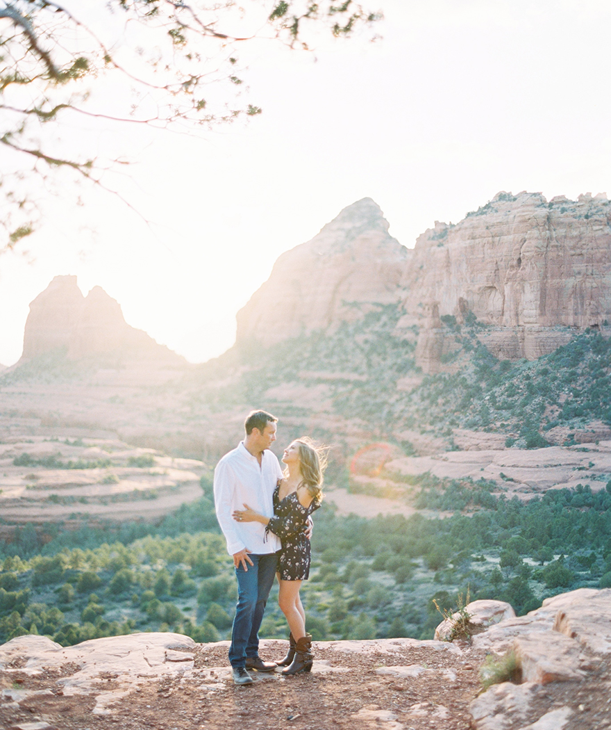 dramatic engagement photo at Merry-Go-Round Rock in Sedona
