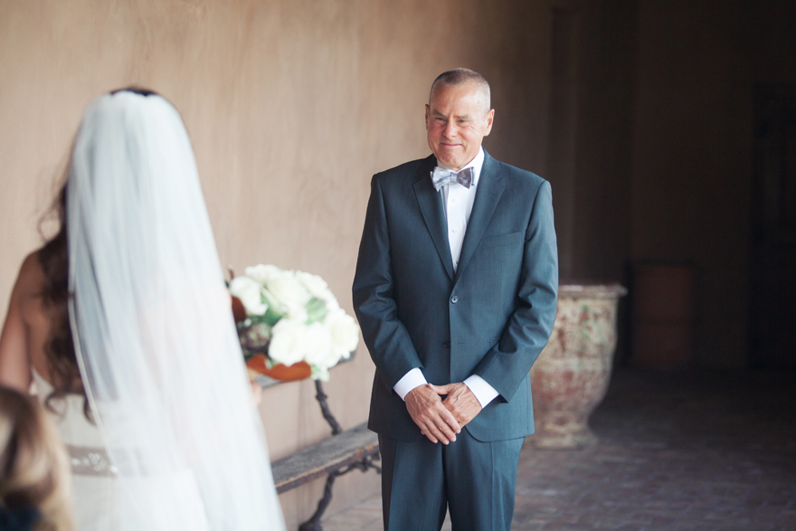 Father of the bride with tears in his eyes as he sees his daughter on her wedding day