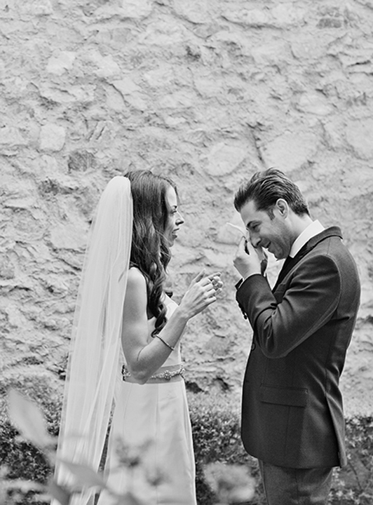 Groom cries as he sees his bride before the ceremony. Emotional first look
