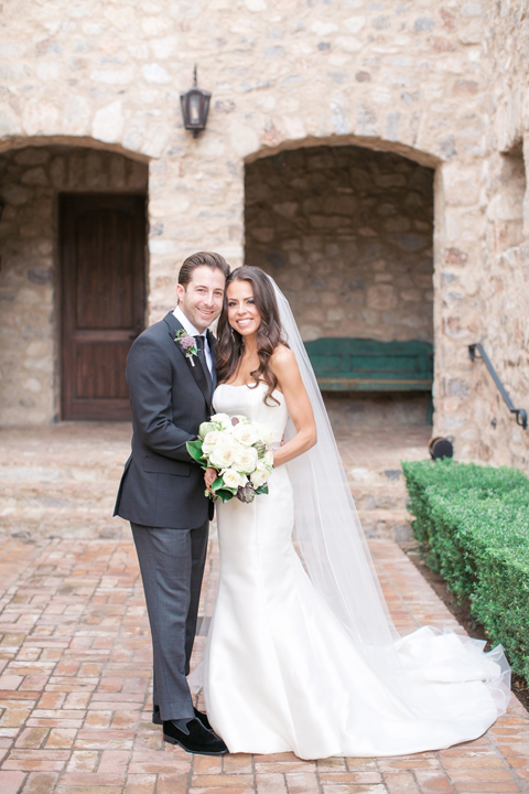Full length portrait of a happy bride & groom. Silverleaf