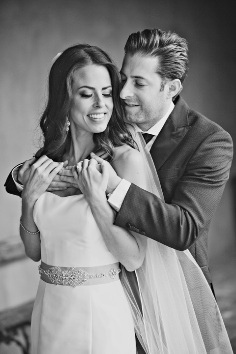 Black and white portrait of the bride and groom. Beautiful couple.