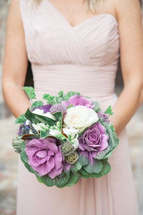 Bridesmaid in a draped blush gown. Vegetable bouquet with kale, roses, magnolia leaves.