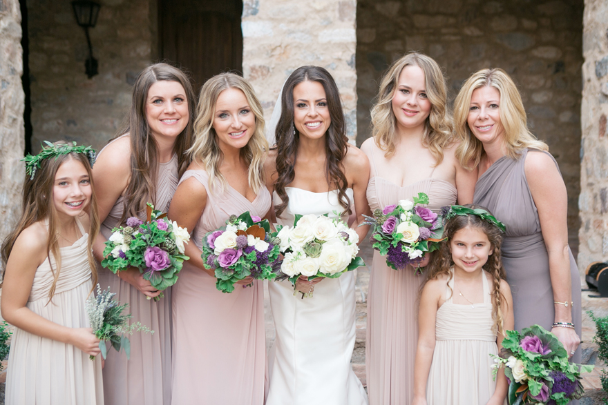 Bridesmaids in draped gowns in neutral colors. Vegetable bouquets with kale, artichokes, flowers.