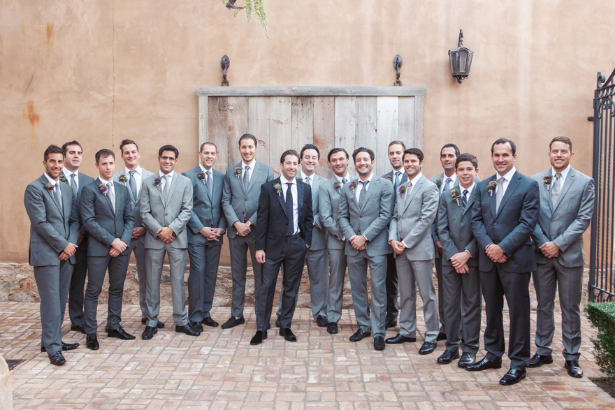 Large bridal party of 16 groomsmen in gray suits
