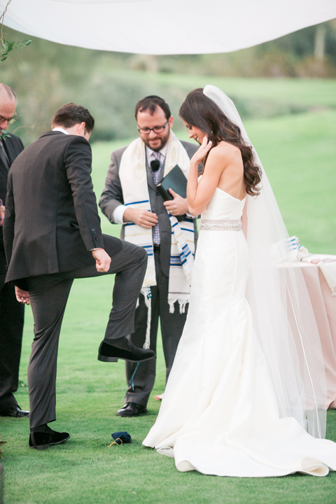 Groom stomps the glass. Outdoor wedding ceremony