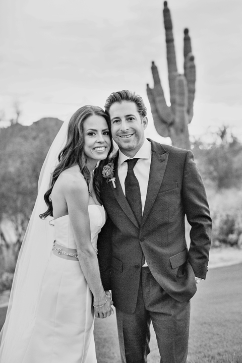 Black & white portrait of a happy bride and groom with cactus in the background. Arizona wedding.