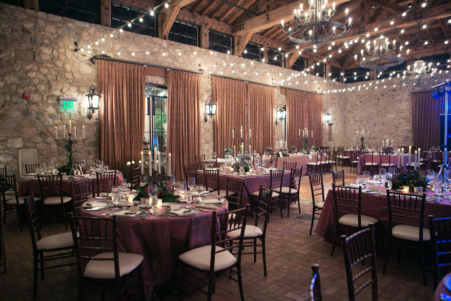Elegant reception with stone walls and purple decor. Silverleaf