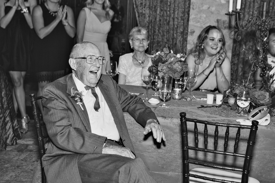 Wedding guests laugh at the toasts during an elegant wedding reception