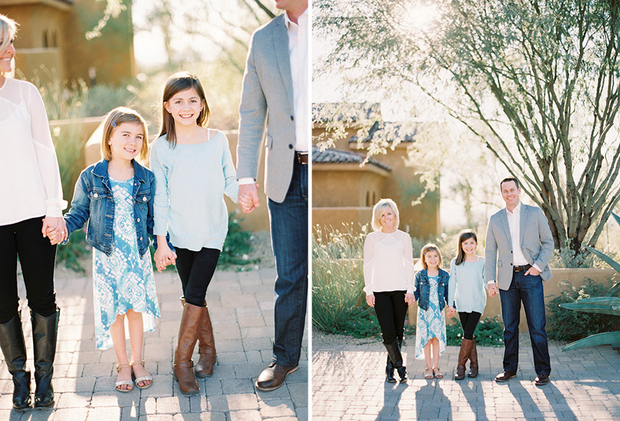 Adorable two daughters holding parents hands in a family session