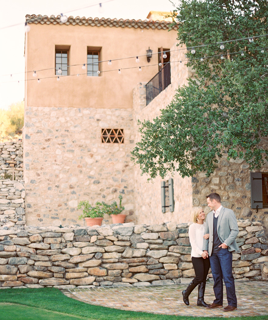 Engaged couple are happy in love outside rocky house photo shoot