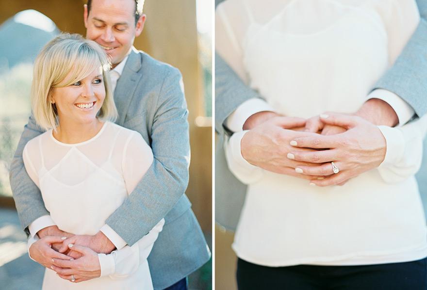 Groom hugs bride and shows exquisite ring in outdoor sunlight