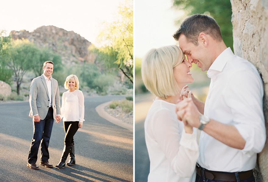 Classy couple stand hand in hand against wall and in open street shoot