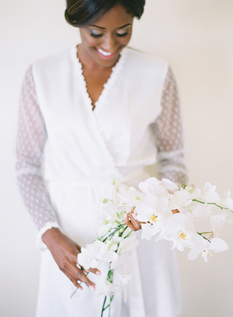 Getting ready - bride with orchids