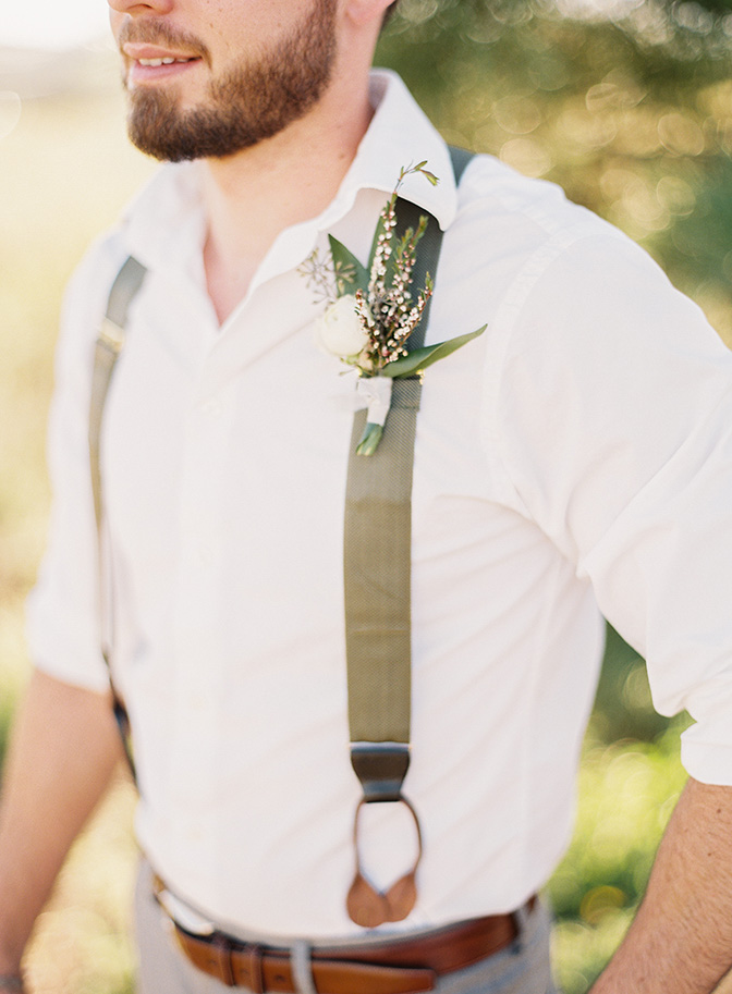boho groom w/ suspenders