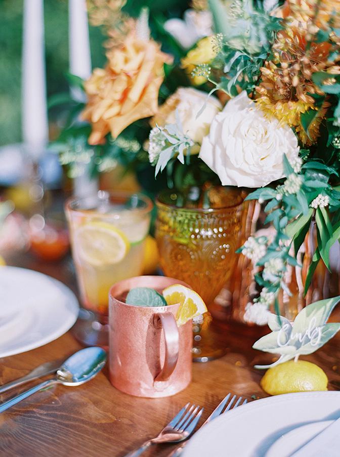 reception table with copper & citrus