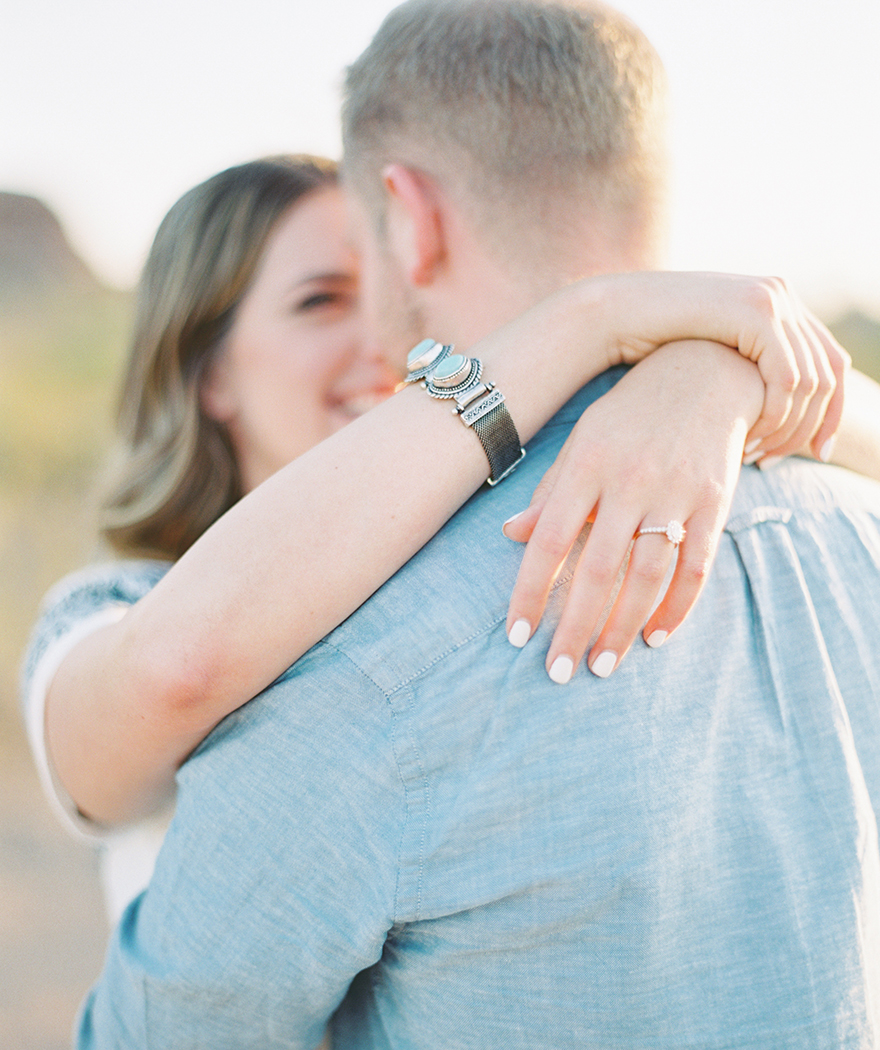 happy embrace in an outdoor Arizona engagement shoot