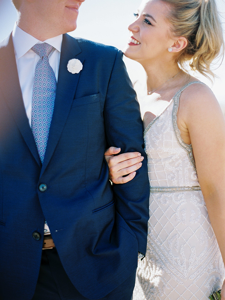 beaded wedding dress and a blue suit