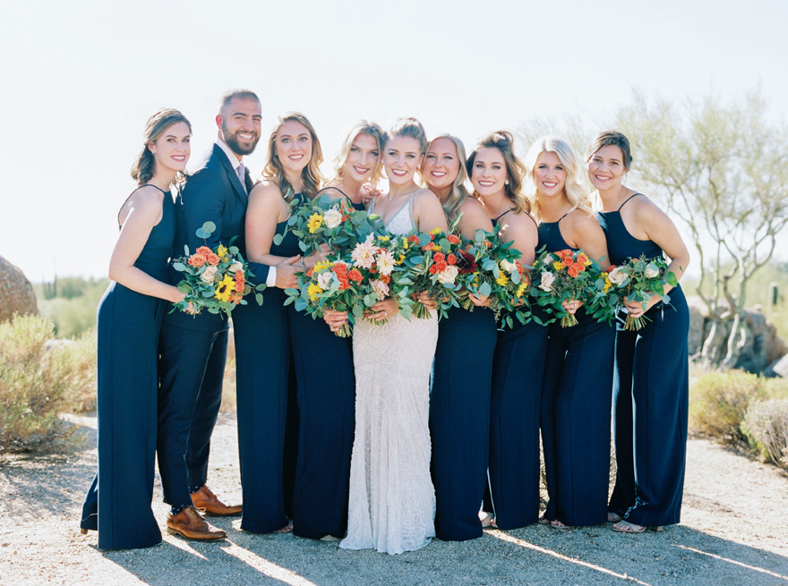 bridesmaids in blue jumpsuits