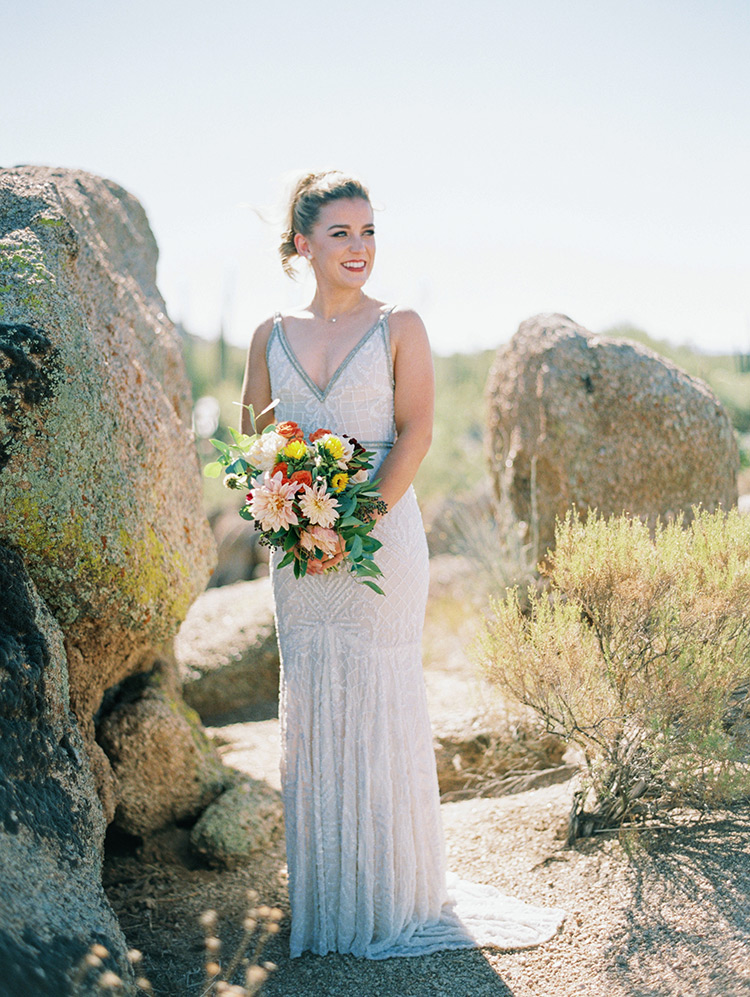 beaded wedding dress and vibrant flowers