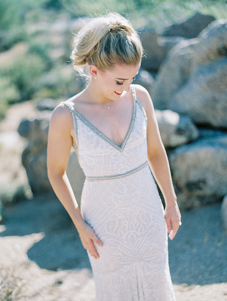 bridal beauty with a ponytail and beaded gown
