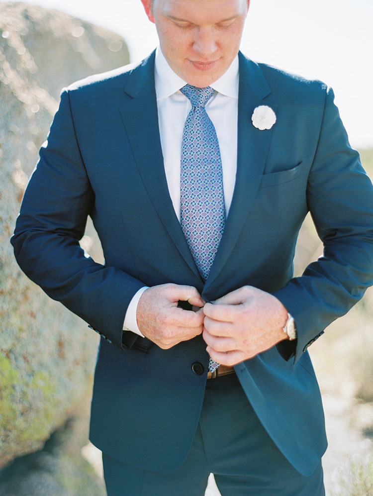 blue suit and a statement tie