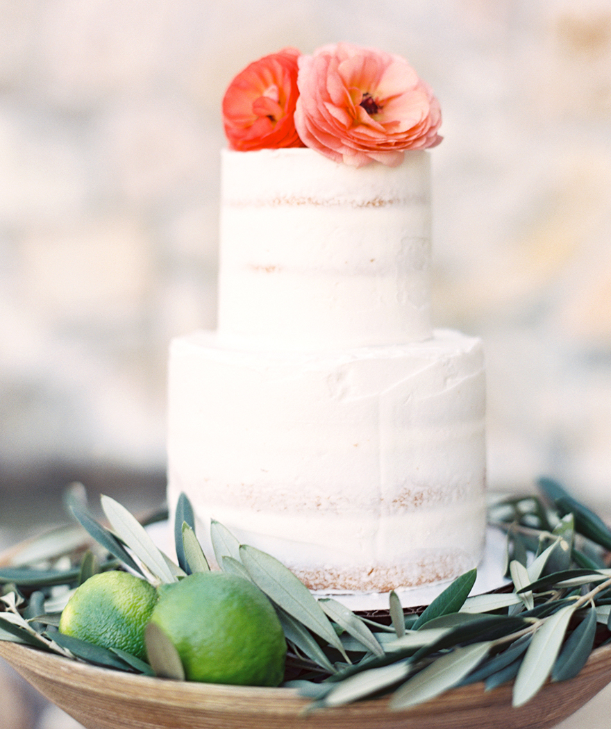 nearly naked cake accented with fresh flowers and greenery