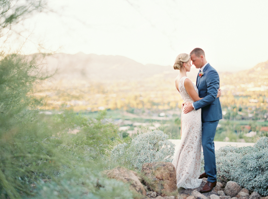 Desert valley behind the bride & groom