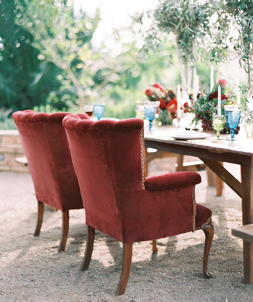 outdoor reception with velvet armchairs