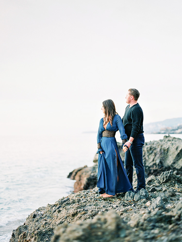 on the craggy rocks at Victoria Beach, engagement photos