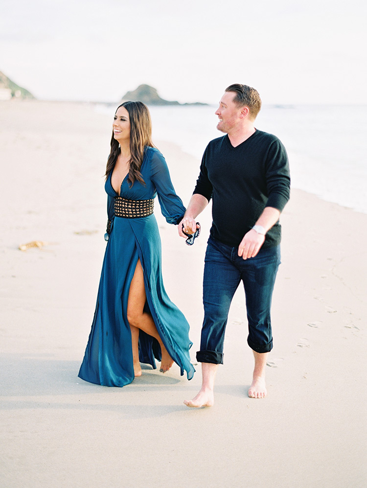 beach engagement shoot, blue cover-up for her & rolled up jeans for him