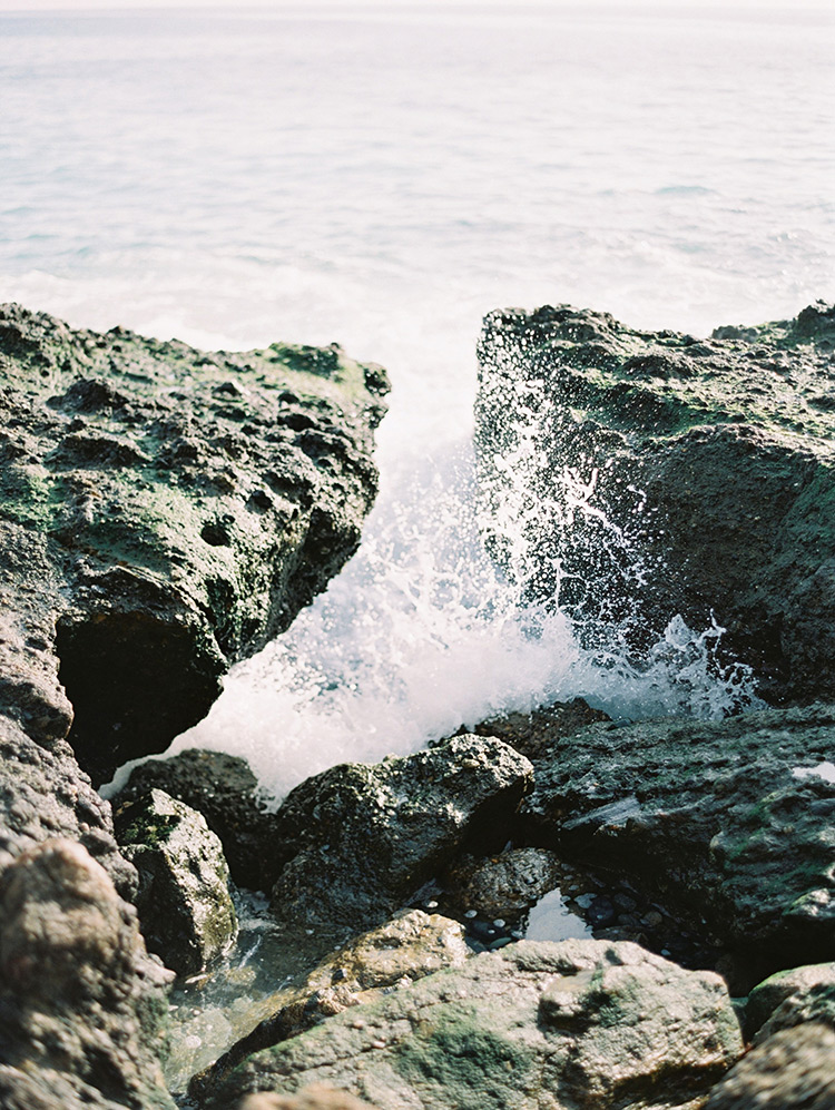 waves break on the rocks at Victoria Beach