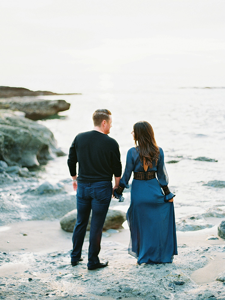 holding hands at Victoria Beach, engagement photos