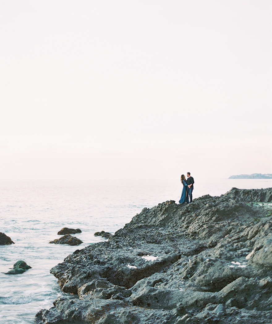 on the craggy rocks near La Tour at Victoria Beach, engagement photos