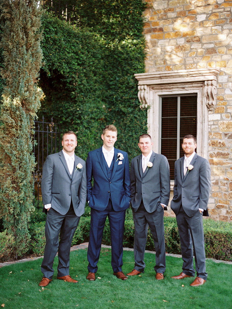 groomsmen in gray with the groom in blue