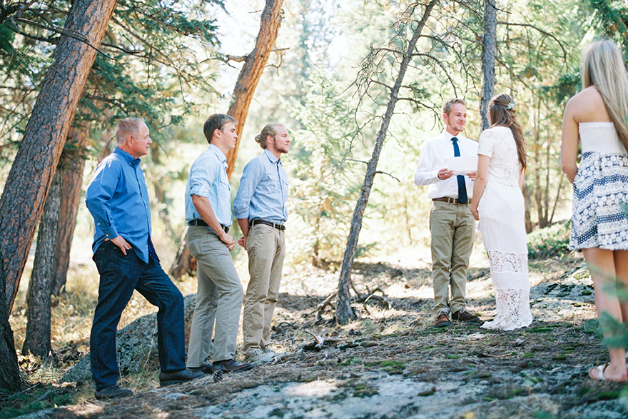 Groom reads vows to bridal party shares this moment. Colorado outdoor weddings.