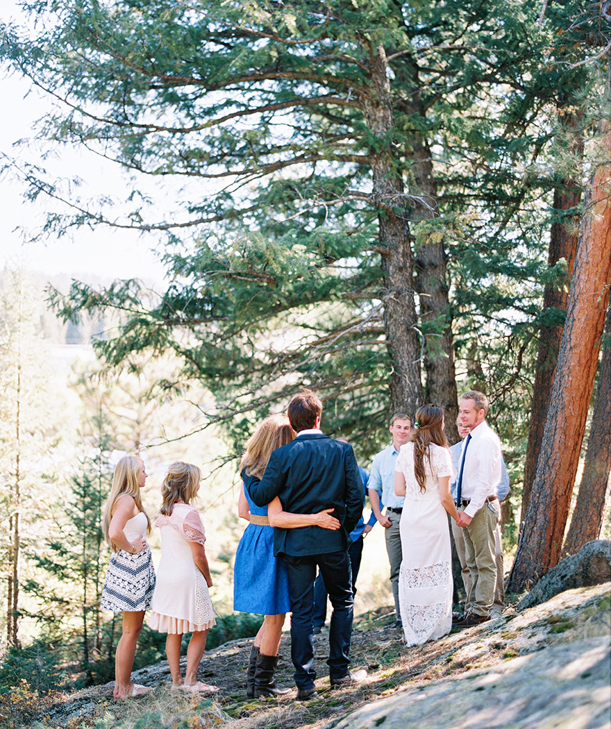 Bride and groom unite in marriage with family. Simple boho wedding Colorado weddings.