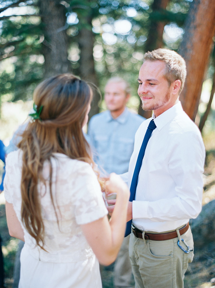 Groom shares a sweet look at his beautiful bride. Natural outdoor wedding