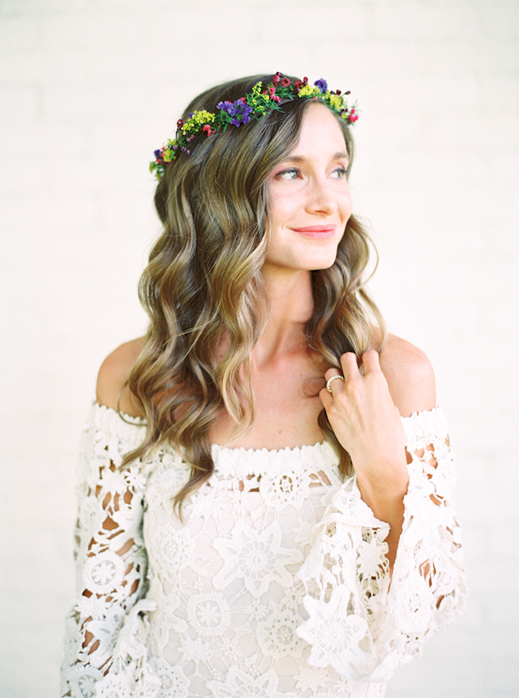 Bride in a delicate flower crown for a bohemian wedding. Long, loose waves of blonde hair