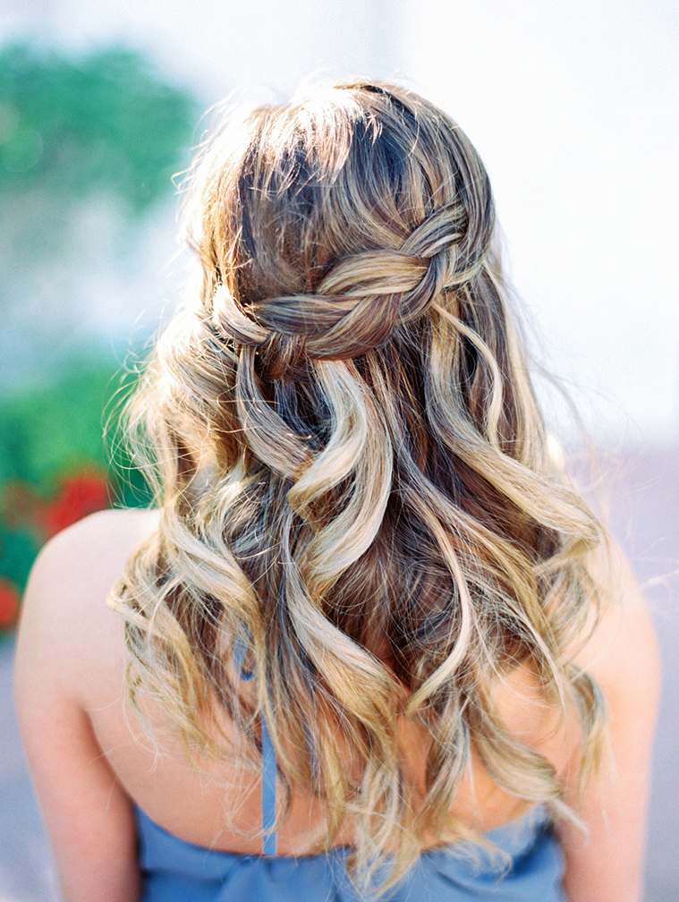 Soft wedding hair, half up in a braid and half in loose waves.