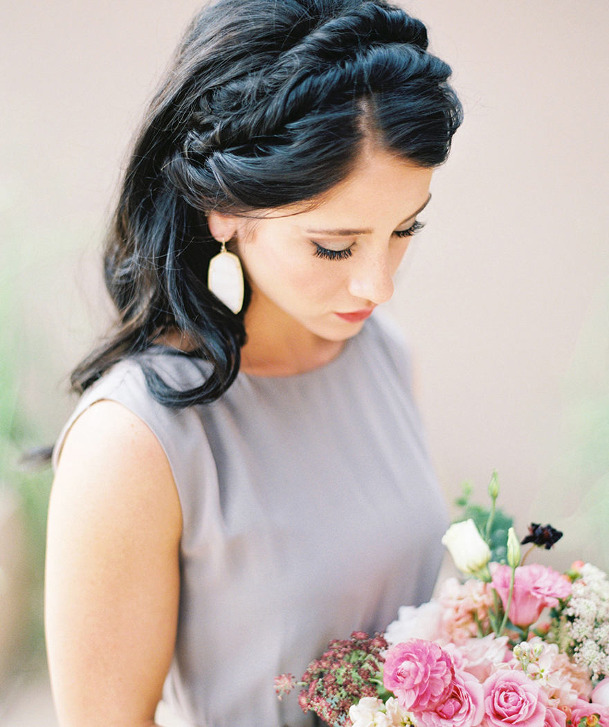 Bridesmaids in a grey, high-necked gown. Hair crowned in twists for a Grecian style.