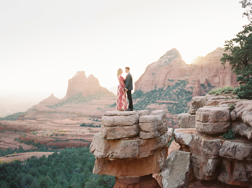 formal clothes atop Merry-Go-Round Rock in Sedona
