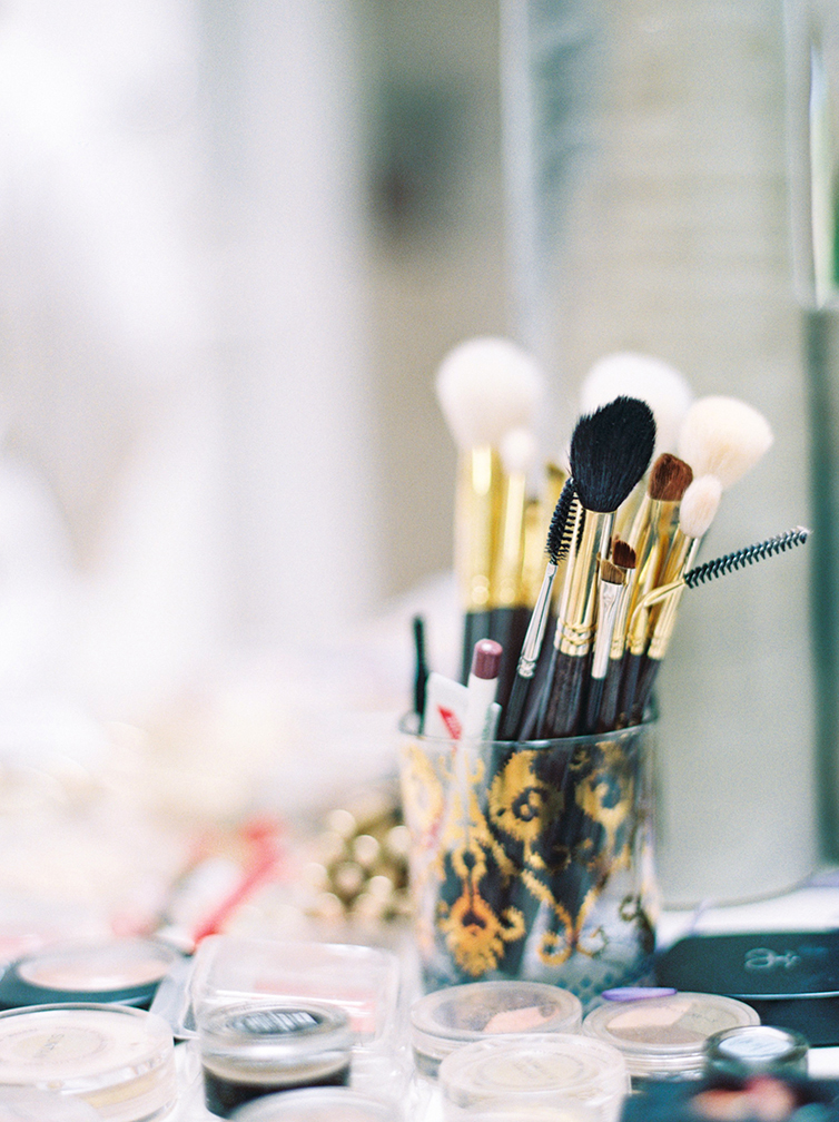 A selection of makeup brushes and cosmetics at the ready.