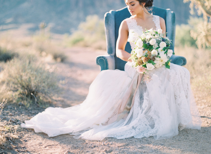 vintage chair and lace gown in the desert